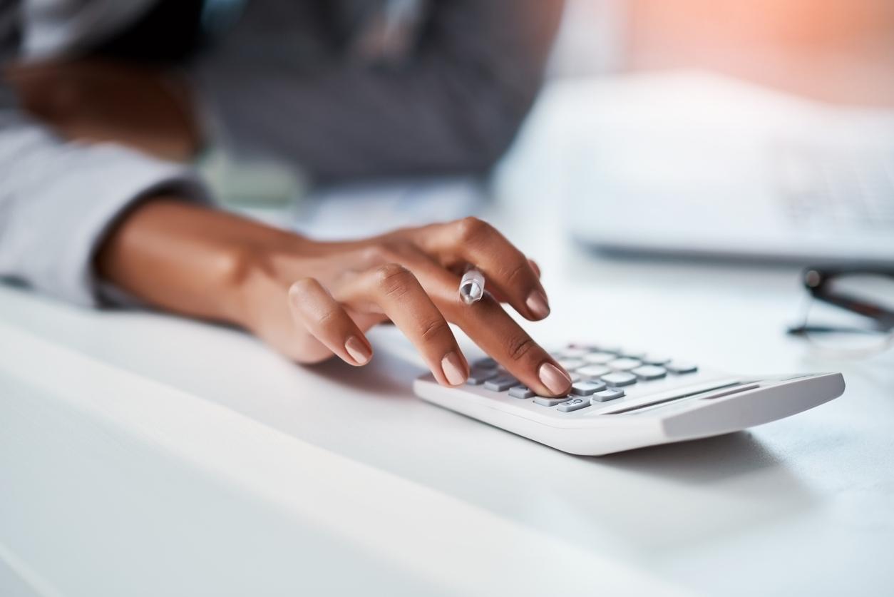 Woman's hand using calculator
